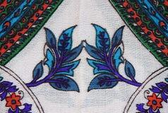 Een bloemenpatroon op de stof in de vorm van een diamant en st Royalty-vrije Stock Foto