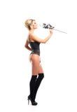 Een blonde vrouw in erotische kleren die nam houden toe Stock Afbeelding