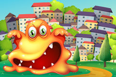 Een boos monster bij het dorp Stock Afbeelding