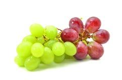 Een bos van rode en groene druiven Stock Foto's