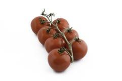Een bos van rode tomaten royalty-vrije stock afbeeldingen
