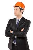 Een bouwingenieur in kostuum het kijken Royalty-vrije Stock Foto