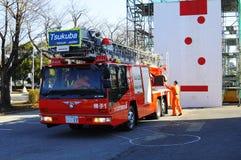 Een brandbrigade op het werk tijdens de aardbeving van Japan Royalty-vrije Stock Fotografie