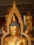 Een bronsstandbeeld van Boedha in Thailand Stock Foto's