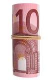Een broodje van 10 Euro nota's. Stock Fotografie