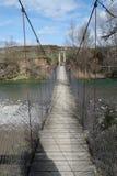 Een brug van het opschortingswater in een niet stedelijke scènedag Royalty-vrije Stock Fotografie