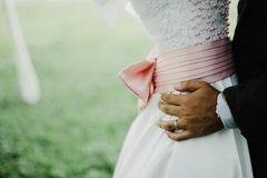 Een bruidegom en een bruid Stock Foto