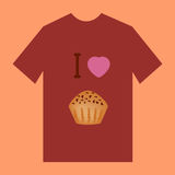 Een bruine t-shirt met beeld van muffin Stock Afbeeldingen