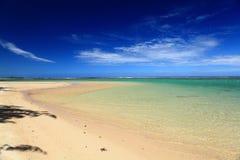 Een charmante overzees met strand Stock Afbeelding