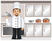 Een chef-kok in een keuken Royalty-vrije Stock Afbeeldingen