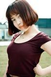 Een Chinees meisje in de tuin Royalty-vrije Stock Afbeeldingen