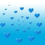 Een cirkel van blauwe harten Stock Foto's