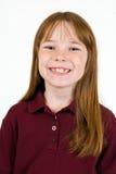 Jong caucasionwijfje in schooloverhemd stock foto's