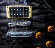 Een close-up van een gitaar Stock Afbeelding