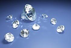 Diamanten op een blauwe oppervlakte Stock Foto's