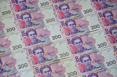 Een close-up van een patroon van vele Oekraïense muntbankbiljetten met een nominale waarde van hryvnia 200 Achtergrond op zaken i Royalty-vrije Stock Fotografie