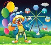 Een clown met ballons dichtbij ferris rijdt Stock Fotografie