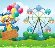 Een clown met ballons en lege signage Stock Fotografie