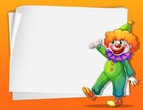 Een clown naast een lege ruimte Stock Foto's