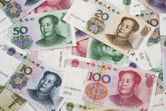 Een colage van Chinese RMB-bankbiljetten Stock Foto's