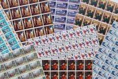 Een colourfullinzameling van bladen van de munt de Britse zegel Stock Afbeeldingen