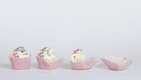 Een cupcake in stadia wordt gegeten dat Stock Foto
