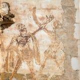 Een 13de eeuw een dans van het freskoskelet op de buitenmuur van Basiliek van st-Sauveur bij Bedevaartstad van Rocamadour royalty-vrije stock afbeeldingen