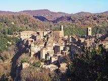 Een de wintermening van het middeleeuwse dorp van Sorano in Toscanië, Italië stock foto's