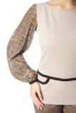 Een deel van de kleding, het wapen en de schouder van vrouwen Stock Fotografie
