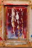 Een deel van een houten deur met verschillende kleuren Royalty-vrije Stock Foto's