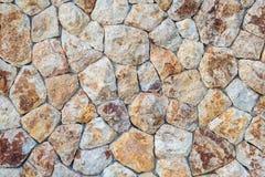 Een deel van een steenmuur Stock Afbeeldingen