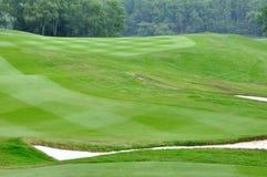 Een deel van golfgazon en zand Stock Fotografie