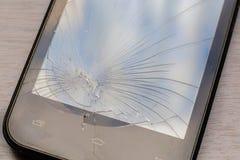 Een deel van het gebroken telefoonscherm Barsten op smartphoneglas stock afbeelding