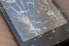 Een deel van het gebroken telefoonscherm Barsten op smartphoneglas stock afbeeldingen