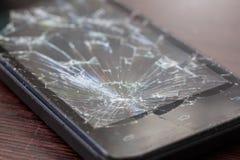 Een deel van het gebroken telefoonscherm Barsten op smartphoneglas stock fotografie