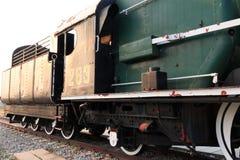 Een detailclose-up van een stoomlocomotief die stoom vrijgeven Uitstekende Trein royalty-vrije stock afbeelding