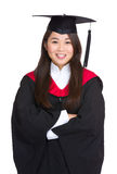 Een diploma behalend studentenmeisje in een academische toga Royalty-vrije Stock Fotografie