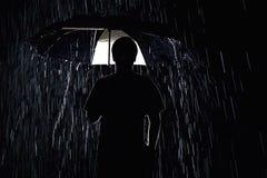 Een donker en regenachtig silhouet Stock Fotografie