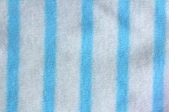 Een donkerblauwe achtergrond van de gingangstof die naadloos is Royalty-vrije Stock Foto's