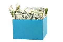 Een doos geld royalty-vrije stock afbeeldingen