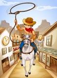 Een dorp met een jonge jongen die in een paard berijden Stock Afbeeldingen