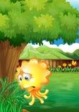 Een droevig geel monster onder de boom Stock Foto