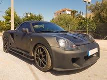Een dure zwarte sportwagen Royalty-vrije Stock Afbeeldingen