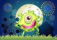 Een eenogig groen monster bij het pretpark stock illustratie