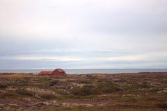 Een eenzame boerderij in IJsland Stock Afbeeldingen