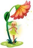 Een fee die zich onder de bloem bevinden Royalty-vrije Stock Foto