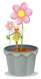 Een fee een bloem houden die zich bevindt op een bloempot Stock Afbeelding