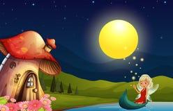 Een fee en haar paddestoelhuis Stock Foto