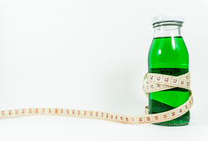 Een fles groene stroop Stock Afbeeldingen