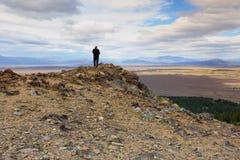 Een fotograaf die luchtmening van Meer Tekapo vangen Stock Foto